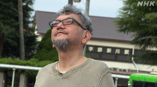 Director Hideaki Anno looking up
